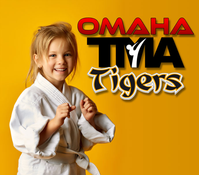 ATA Tigers Logo with Baeoh the cartoon tiger and a young girl doing a side kick